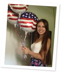 ASSE Exchange Student Holding Balloons from Host Family